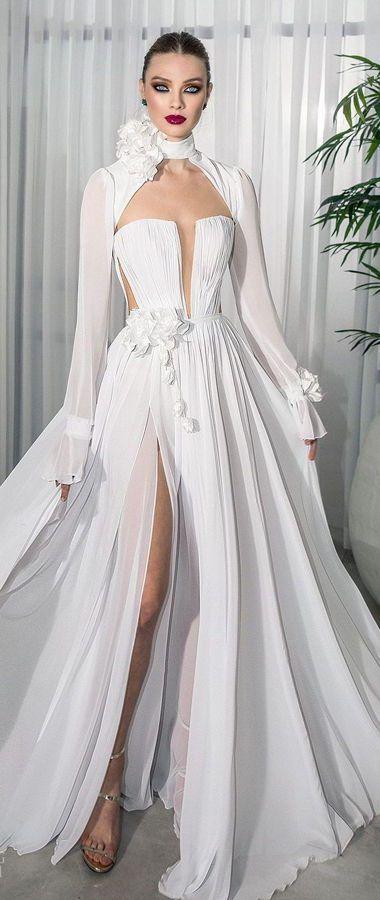 Великолепные свадебные платья с длинными рукавами и высоким воротом. Платья украшенные цветами, с разрезом от дизайнера Lior Charchy. Коллекция 2020