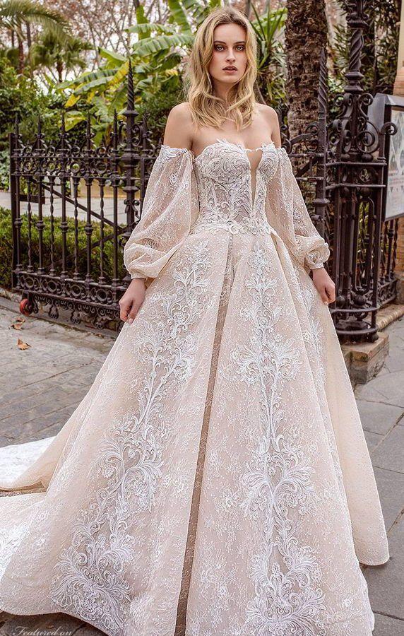 Свадебное платье А- силуэта со спущенными рукавами фонариками и открытой линией декольте. Полотно полностью расшито авторским кружевом и пайеткой. Wedding Dress 2020 - Ricca Sposa