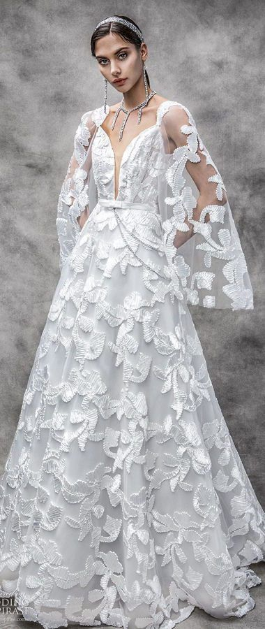 Свадебное платье с длинными рукавами-колокольчиками и глубоким v-образным вырезом декольте. Victoria KyriaKides 2020 Bridal Collection