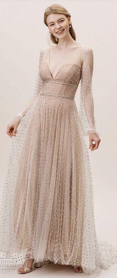 Свадебное, изысканное платье, полностью украшенное кристаллами. Глубокий V-образный вырез и двойная окантовка на талии и прозрачные рукава. BHLDN's Gorgeous Wedding Dresses 2020