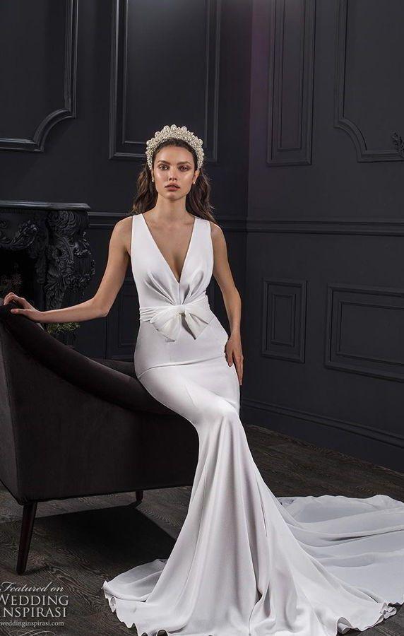 Свадебное платье силуэта «русалка» в стиле Голливуда с бантом на талии и глубоким v-образным вырезом декольте. Lihi Hod Spring 2020 Bridal Collection