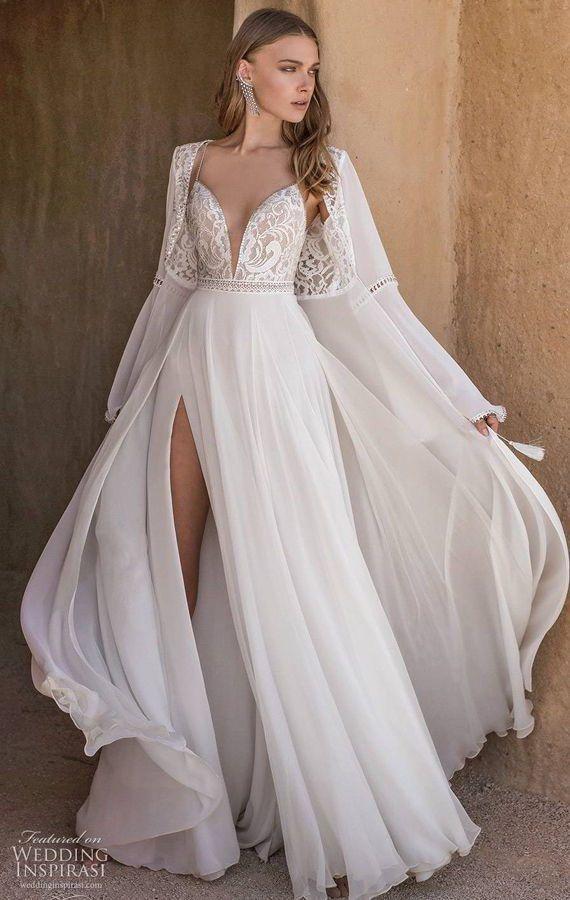 Свадебное платье с асимметричный разрезом юбки и глубоким вырезом декольте, с накидкой. Asaf Dadush 2020 Wedding Dresses